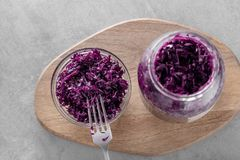 Purple naturally cured fermented sauerkraut in bowl royalty free stock image