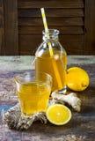 Homemade fermented raw ginger lemon kombucha tea. Healthy natural probiotic flavored drink. Copy space. Homemade fermented raw ginger lemon kombucha tea Stock Photos