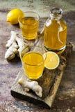Homemade fermented raw ginger lemon kombucha tea. Healthy natural probiotic flavored drink. Copy space. Homemade fermented raw ginger lemon kombucha tea Stock Photo