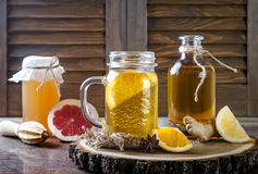 Homemade fermented raw kombucha tea with different flavorings. Healthy natural probiotic flavored drink. Copy space. Homemade fermented raw kombucha tea with Stock Image