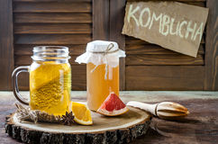 Homemade fermented raw kombucha tea with different flavorings. Healthy natural probiotic flavored drink. Copy space. Homemade fermented raw kombucha tea with stock images