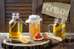 Homemade fermented raw kombucha tea with different flavorings. Healthy natural probiotic flavored drink. Copy space. Homemade fermented raw kombucha tea with royalty free stock photos