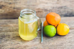 Homemade Fermented Raw Kombucha Tea Ready to Drink With orange and lime. Summer Stock Photos