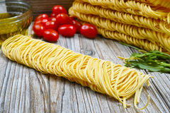 Homemade fettuccini pasta, small red tomatoes Royalty Free Stock Photo
