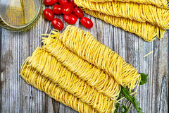 Homemade fettuccini pasta, small red tomatoes Royalty Free Stock Photography