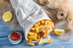 Homemade fish and chips served in paper Stock Photos