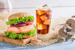 Homemade fishburger with salmon made by fisherman Stock Images
