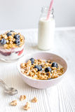 Homemade fitness granola with yoghurt and berries on white kitchen background Royalty Free Stock Photo