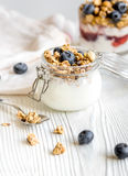Homemade fitness granola with yoghurt and berries on white kitchen background Royalty Free Stock Photography