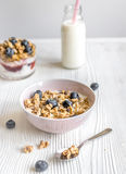 Homemade fitness granola with yoghurt and berries on white kitchen background Stock Photos