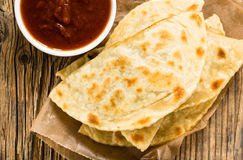 Homemade flatbread with salsa viewed from abov. Homemade flatbread with meat, cheese, and salsa viewed from above. Yantyk - traditional Crimean tatar flat bread Royalty Free Stock Photo