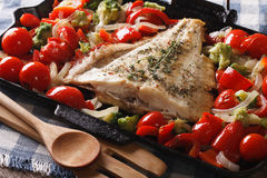 Homemade flatfish with vegetables close-up in a pan. Horizontal Royalty Free Stock Photos