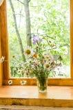 Homemade flowers. Still life on the windowsill. royalty free stock photo
