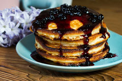 Homemade fluffy pancakes drizzled blueberry jam Stock Photo
