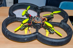 Homemade flying drone with four propellers controlled remotely by a computer program. Homemade flying drone with four propellers controlled remotely by computer royalty free stock photos
