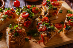 Homemade focaccia with tomatoes, sun-dried tomatoes, mozzarella Royalty Free Stock Photos