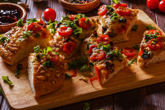 Homemade focaccia with tomatoes, sun-dried tomatoes, mozzarella Royalty Free Stock Images
