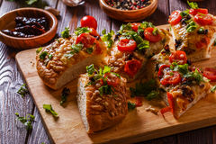 Homemade focaccia with tomatoes, sun-dried tomatoes, mozzarella Royalty Free Stock Photography