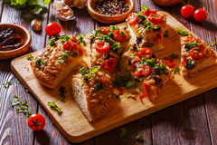 Homemade focaccia with tomatoes, sun-dried tomatoes, mozzarella Stock Images