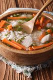 Homemade Food: Chicken rice soup in a wooden bowl. Vertical Stock Photos