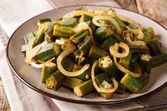 Homemade food: delicious healthy okra fried with onion close-up stock photo