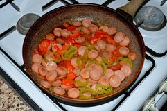 Homemade food - fast food. sausage, bell peppers, tomatoes and eggs. stock photos