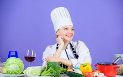 Homemade food tips. Turn ingredients into delicious meal. Culinary skills. Woman chef wear hat apron near table. Ingredients. Girl adorable chef teach culinary royalty free stock photos
