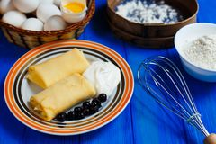 Hot fresh homemade pancakes served with sour cream and berries, royalty free stock photography
