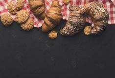 Homemade french croissants and cookies on wood Royalty Free Stock Photo