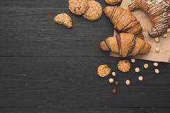 Homemade french croissants and cookies on wood Stock Photo