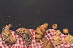 Homemade french croissants and cookies on wood Royalty Free Stock Images