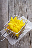 Homemade french fries in a frying basket Stock Images