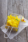 Homemade french fries in a frying basket Stock Photography