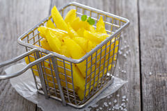 Homemade french fries in a frying basket Royalty Free Stock Photos
