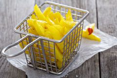 Homemade french fries in a frying basket Royalty Free Stock Photo