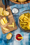 Homemade French fries made from potatoes Royalty Free Stock Photo
