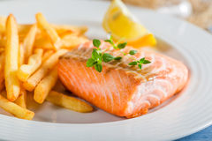 Homemade french fries with salmon served on plate Stock Image