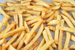 Homemade french fries on a tray background. Closeup shot Royalty Free Stock Photography