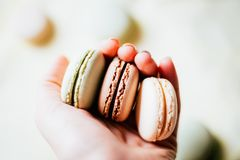 Homemade French Macaroons on the Plate, Pistachio, Coffee and Va stock photography