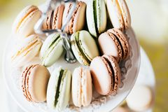 Homemade French Macaroons on the Plate, Pistachio, Coffee and Va stock images