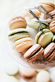 Homemade French Macaroons on the Plate, Pistachio, Coffee and Va royalty free stock photo