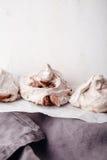 Homemade french meringue on white baking paper with gray towel. Homemade french meringue on white baking paper Royalty Free Stock Image