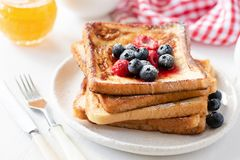 Homemade french toast with fresh berries and honey royalty free stock photo