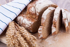 Homemade fresh baked bread and knife Royalty Free Stock Photography