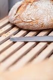 Homemade fresh baked bread and knife Stock Images
