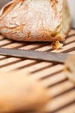 Homemade fresh baked bread and knife Royalty Free Stock Image