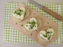 Fresh cheese hearts with cress sprouts on baguette. Homemade fresh cheese hearts with cress sprouts on baguette Stock Images