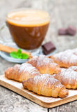 Homemade fresh chocolate croissant with cup of cappuccino Stock Photo