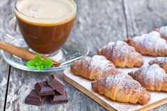 Homemade fresh chocolate croissant with cup of cappuccino Royalty Free Stock Photography