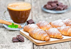 Homemade fresh chocolate croissant with cup of cappuccino Stock Photos